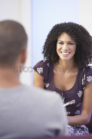 Group portrait : Casually dressed businesswoman talking to colleague in office