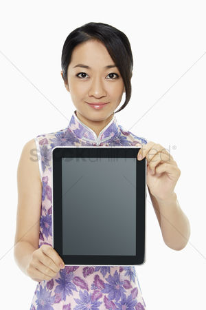 Lunar new year : Cheerful woman holding up a digital tablet