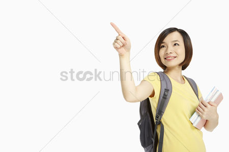 China : Cheerful woman pointing to the right