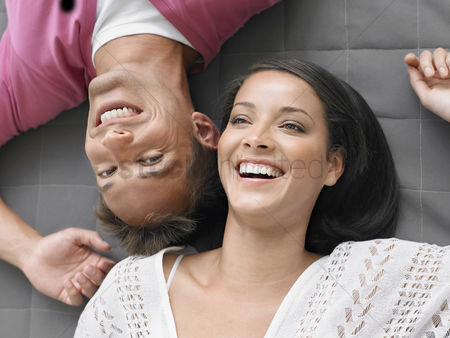 Smile : Cheerful young couple lying down