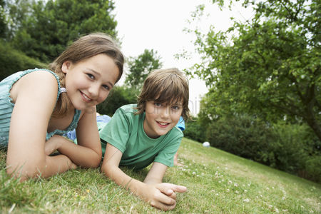 Posed : Children lying on meadow