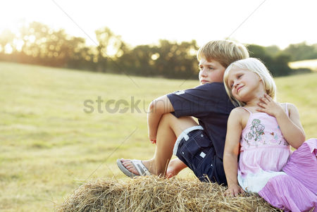 Young boy : Children sitting on a haystack