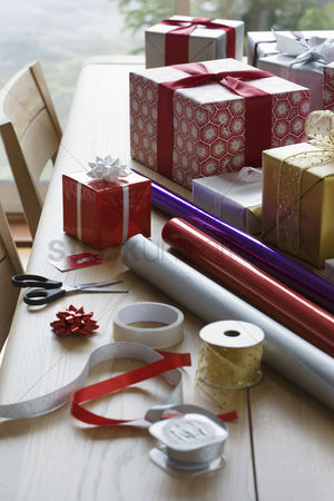 Accessories : Christmas gifts wrapping paper and accessories on table
