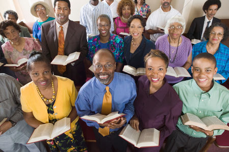 Religion : Church congregation sitting on church pews with bible portrait high angle view