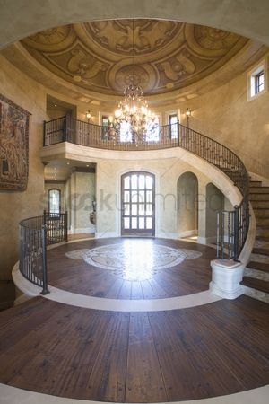 Spacious : Circular entrance hallway and staircase with handrail palm springs