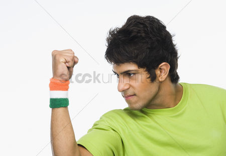 Respect : Close-up of a man clenching fist in excitement