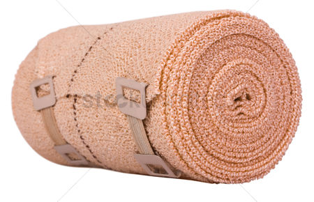 First : Close-up of a rolled-up bandage