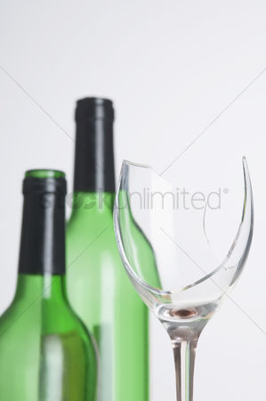 Wine bottle : Close-up of a wine glass with two wine bottles
