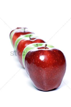 Choosing : Close-up of apples in row on white background