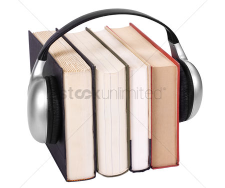 Collection : Close-up of books with headphones