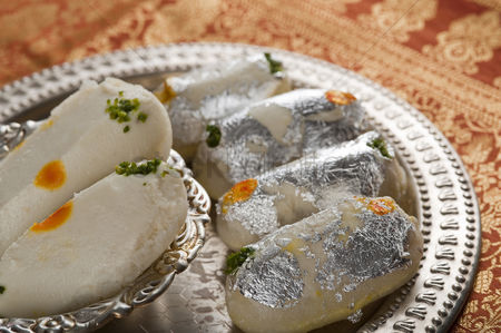 Diwali : Close-up of cham cham a traditional indian sweet made from chhena  cottage cheese  and khoya  solid milk