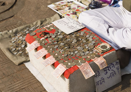 Collection : Close-up of coins at a money exchange stall  delhi  india