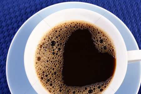 Black background : Close up of cup with coffee