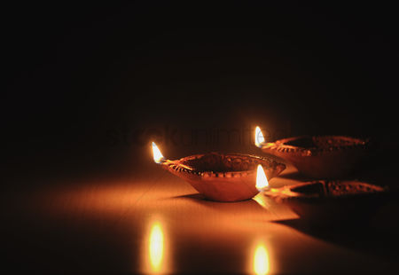 Religion : Close-up of diwali oil lamps