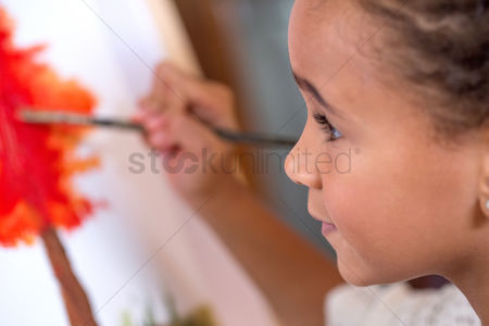 Paint brush : Close up of little girl painting on canvas