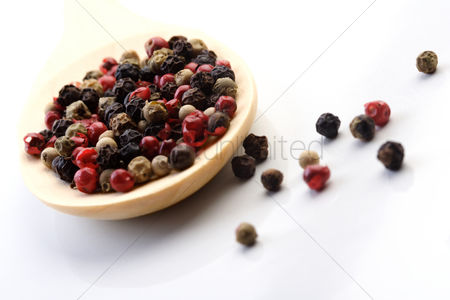 Black background : Close up of pepper grains