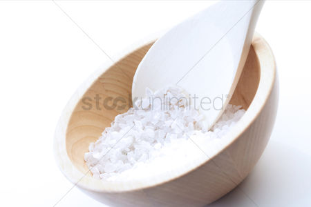 Black background : Close up of salt grains on spoon