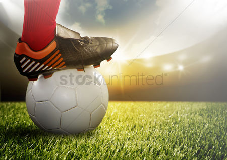 Pitch : Close up of soccer player on a ball