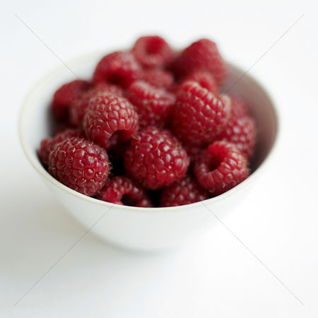 Food  beverage : Close up of some raspberries in a bowl