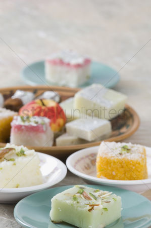 Almond : Close-up of sweets in plate and saucer