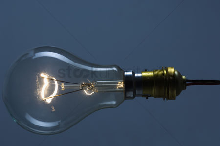Excited : Close-up of the lit filament of a bulb