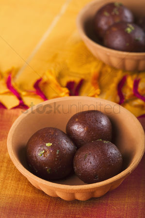 Diwali : Close-up of two bowls of gulab jamuns  a popular traditional indian sweet