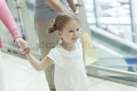 Offspring : Close-up of young girl holding parents hands