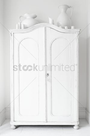 England : Closed storage cupboard painted white