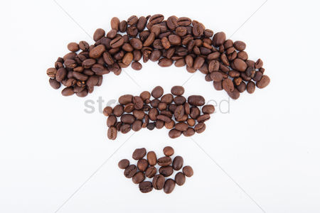 Conceptual : Coffee beans in a wifi symbol