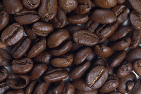 Black background : Coffee grains - close up