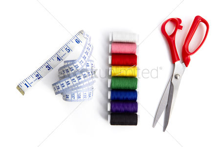 Selection : Colourful sewing threads  measuring tape and scissors design