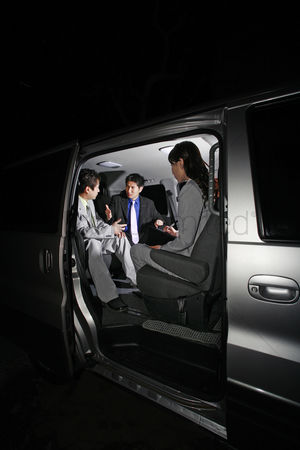 Spacious : Corporate people having discussion in the car