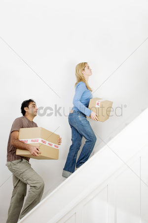 Stairs : Couple carrying boxes up the stairs