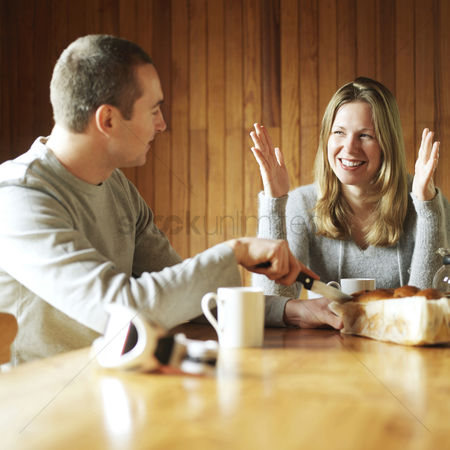 Refreshment : Couple chatting while having breakfast together