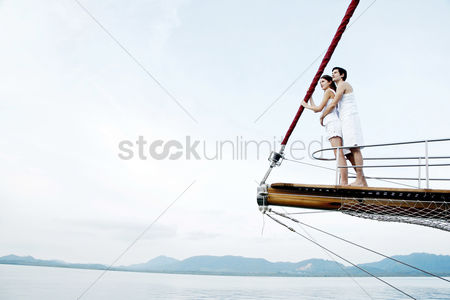 Transportation : Couple cruising on a yacht