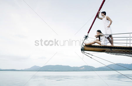 Outdoor : Couple cruising on a yacht