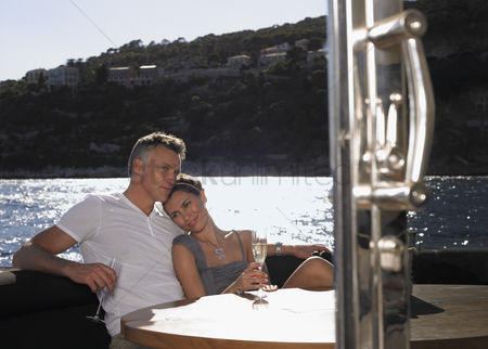 Relationship : Couple drinking champagne on boat