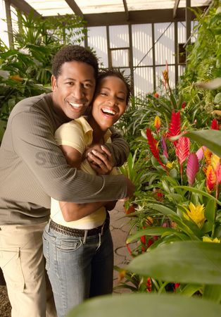 Greenhouse : Couple embracing in plant nursery