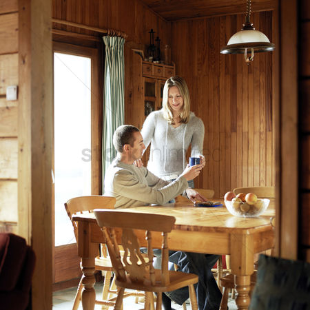 Lover : Couple enjoying hot drinks in the chalet