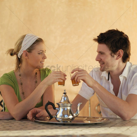 Celebrating : Couple enjoying their drinks