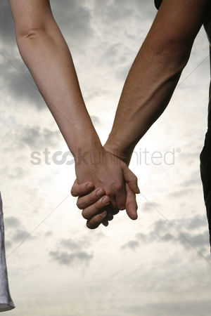 Enjoying : Couple holding hands