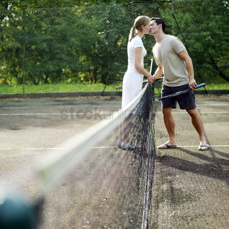 Match : Couple kissing in tennis court