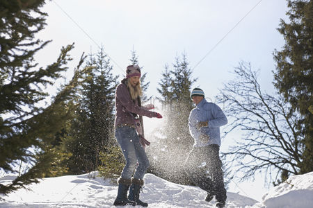 Fight : Couple playing in snow on hill