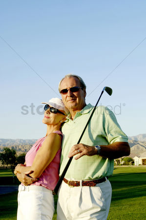 Three quarter length : Couple posing in the golf course