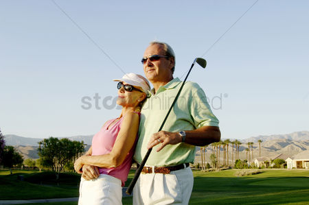 Two people : Couple posing in the golf course
