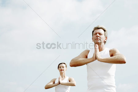 Outdoor : Couple practicing yoga