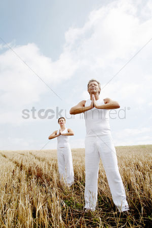 Grass : Couple practicing yoga