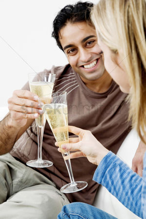 Toasting : Couple toasting drinks in their new house