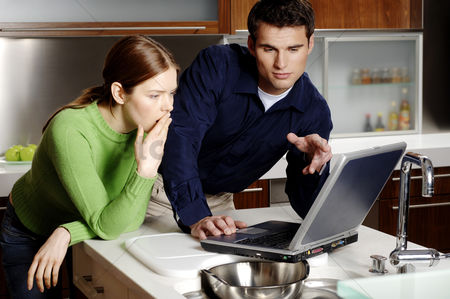 Girlfriend : Couple using laptop in the kitchen