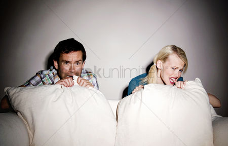 Friends : Couple watching horror movie on the bed